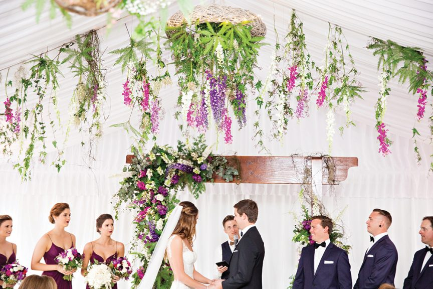 Overhanging florals for this wedding ceremony.