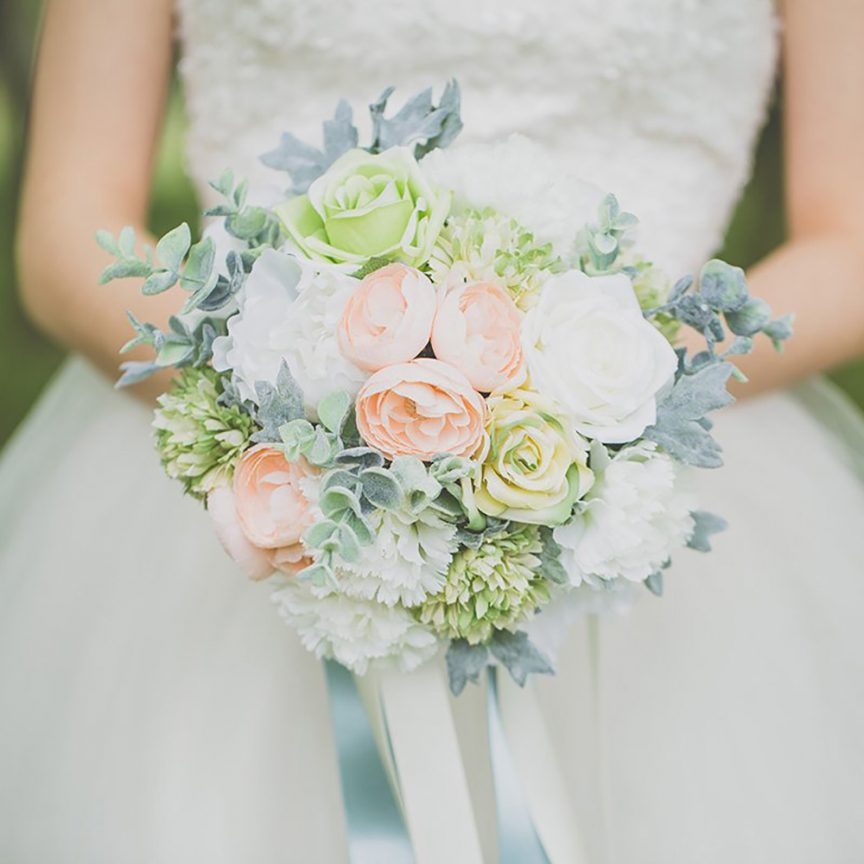 Peach, green and white floral bouquet with succulents