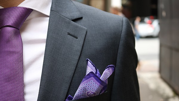 Purple tie and patterned pocket square from Elio Moda.