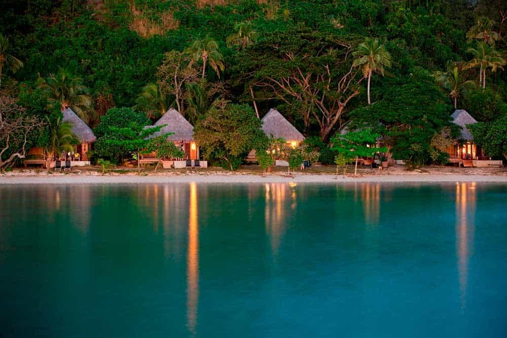 Honeymoon Fiji: individual huts at night.