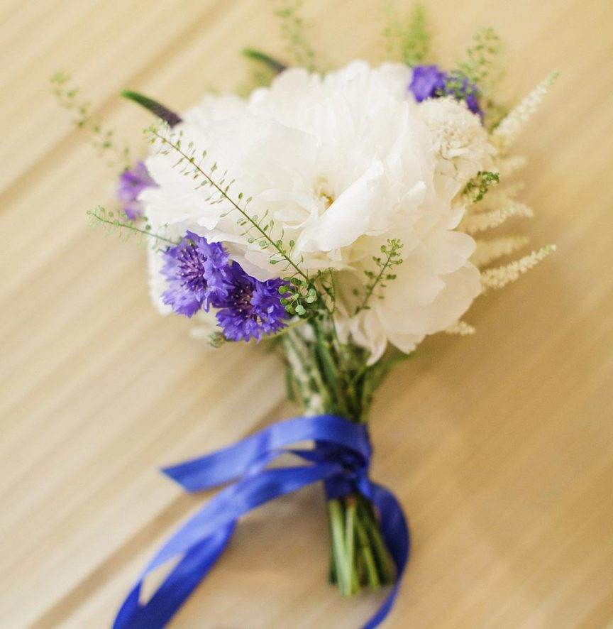 Nosegay bouquet with purple and white florals.