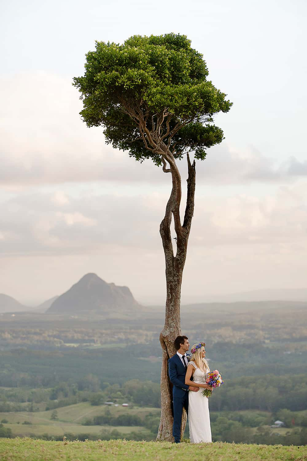 Bride and groom on a hill photographed by Christopher Thomas Photography.