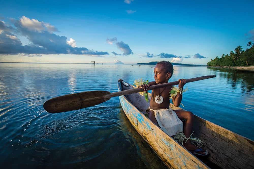 Honeymoon Solomon Islands: Local kid canoeing.