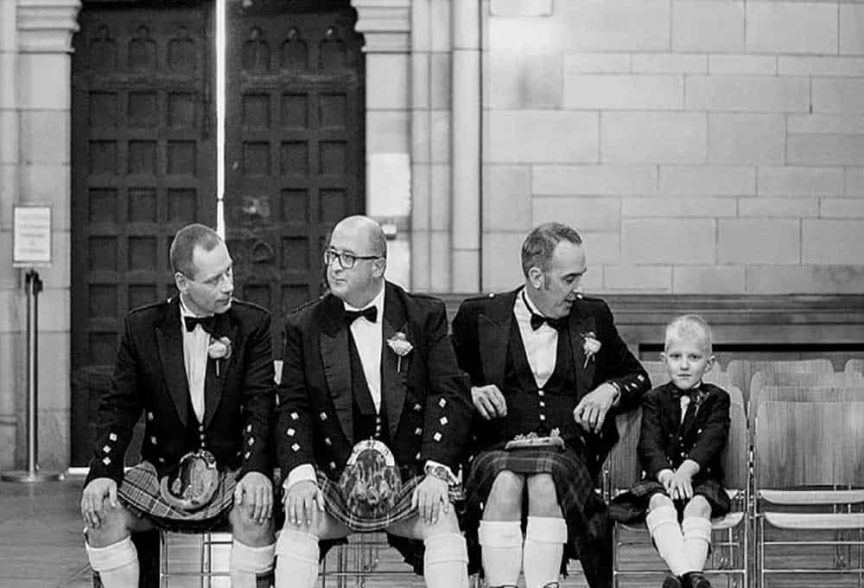 Groom and groomsmen in traditional Scottish kilts photographed by Christopher Thomas Photography.