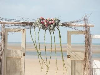 Beach ceremony style.