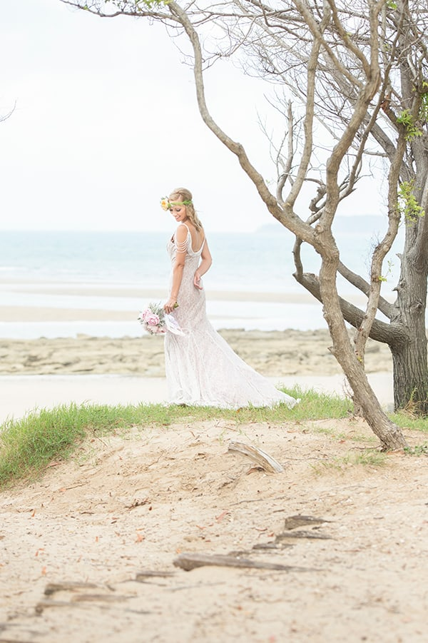 A bride at her beach wedding ceremony.