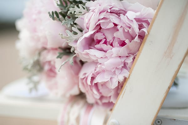 Dusty pink wedding florals for a beach ceremony.