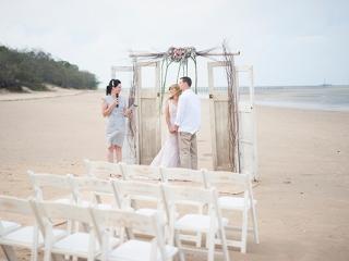 Intimate vintage-style beach ceremony.