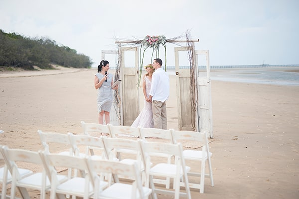 Intimate vintage-style beach ceremony.