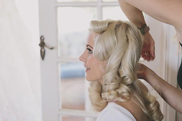 Bride Amanda getting her hair done.