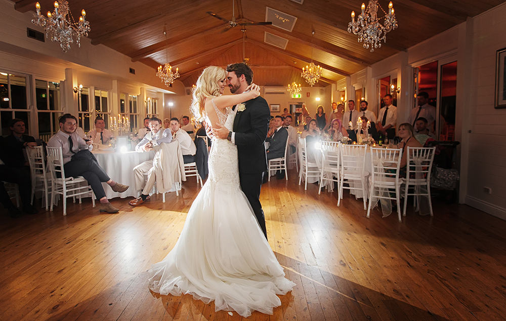 Bride and groom having their first wedding dance.