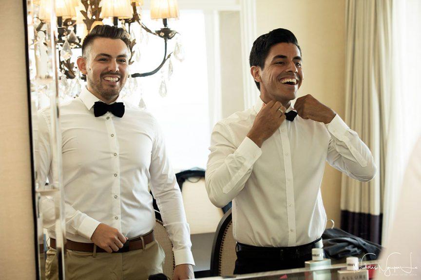 Groom + groomsman getting ready for the wedding.