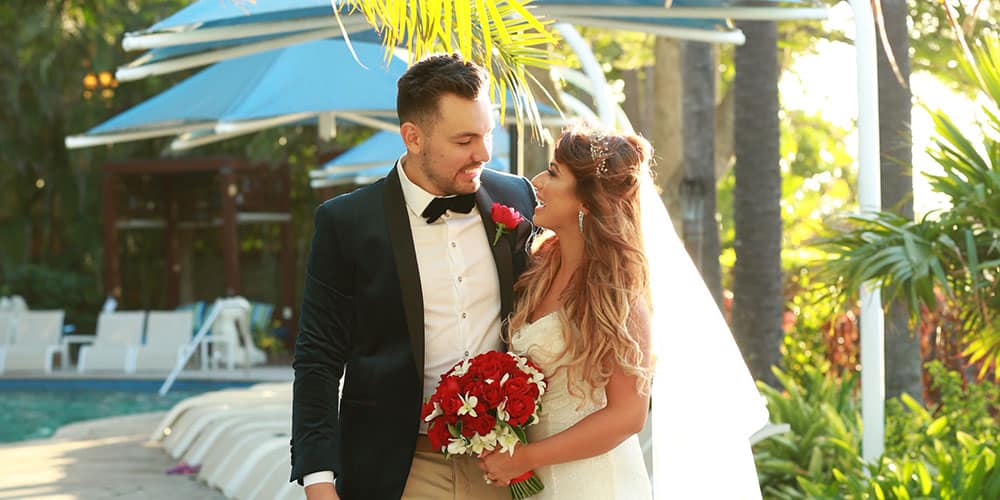 Bride and groom by the pool at Surfers Paradise Marriott Resort & Spa