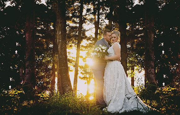 Sunsetting behind the bride and groom