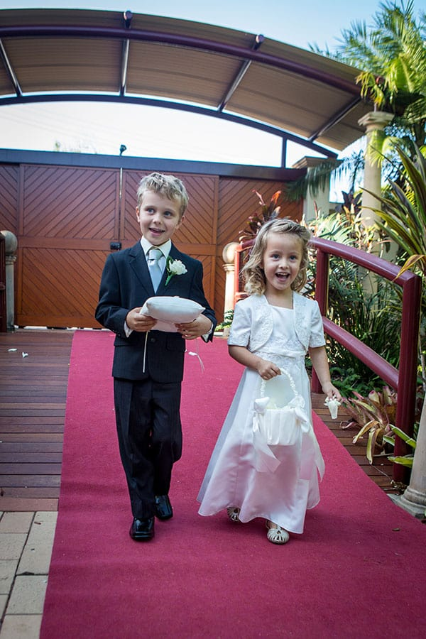 Paige boy and flower girl walking down the aisle