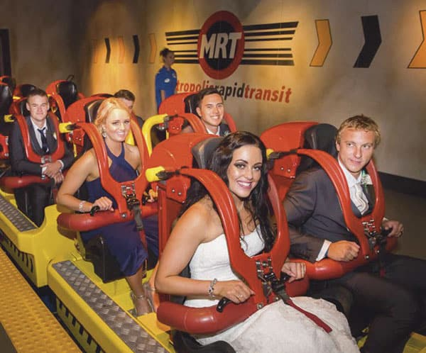 A Movie World wedding: The bridal party on the Superman Escape roller coaster.