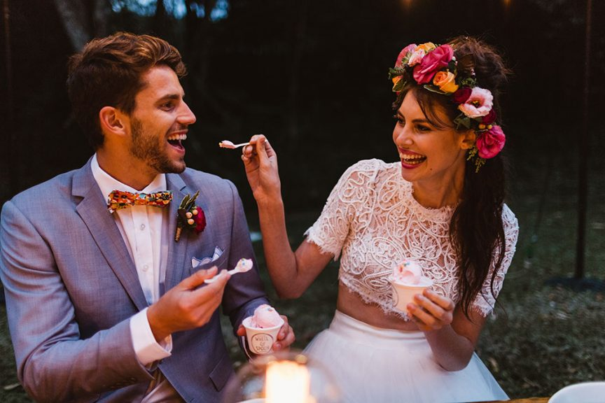 Bride and groom sharing icecream by Wheel and Spoon