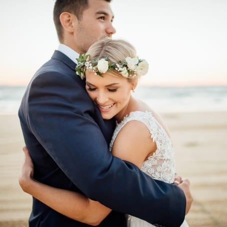 A beach wedding at sunset