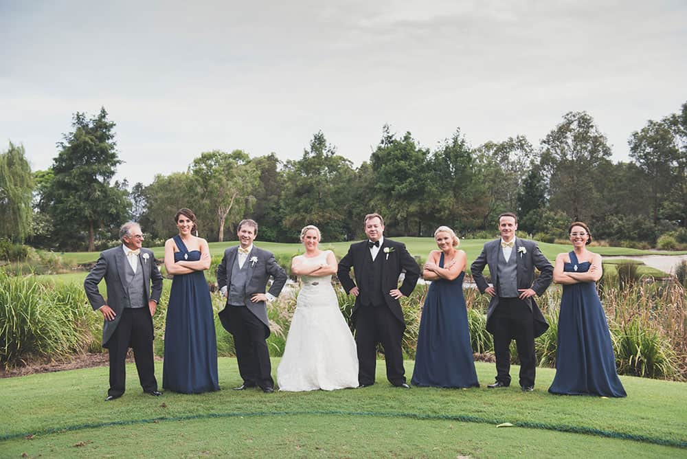 Bride, groom and their bridal party at Lakelands Golf Club