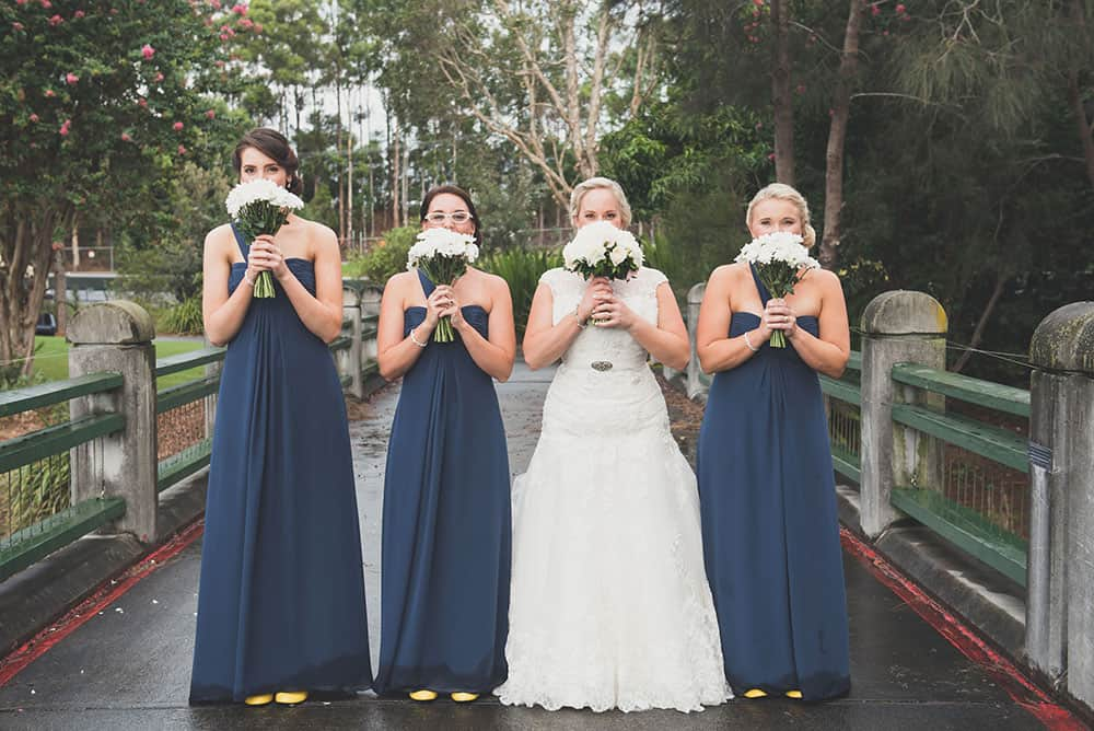Bride Esther and her bridesmaids with their bouquets at Lakelands Golf Club