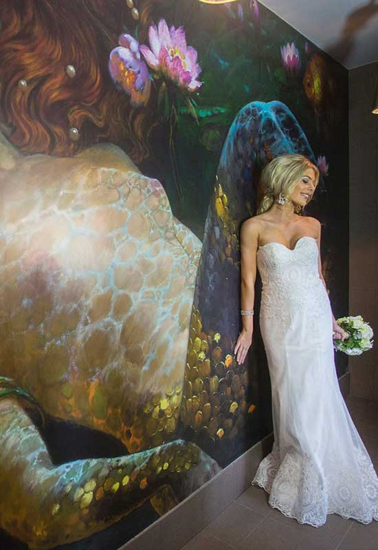 Lure Whitsundays - Bride against mermaid backdrop at Lure Abell Point