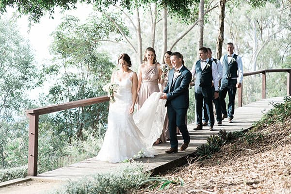 Bridal party walking to get photos at Mercure Clear Mountain Lodge.