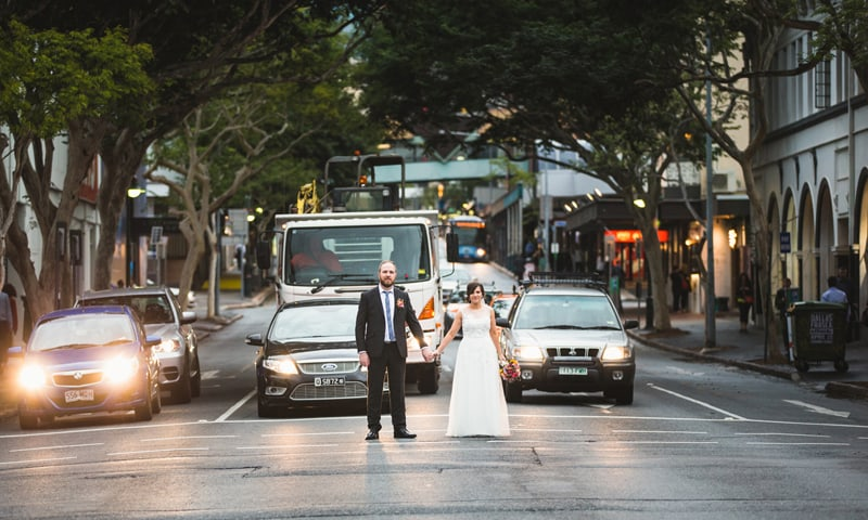 A bride and groom that stop traffic!