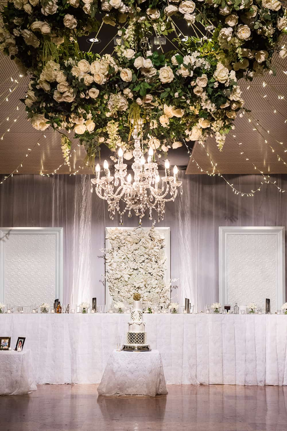 Real wedding reception setting with floral piece at the Greek Club