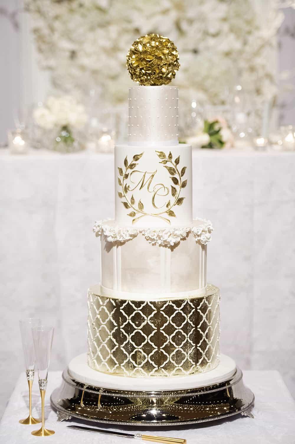 Elegant white + gold 4 tier wedding cake - Queensland Brides