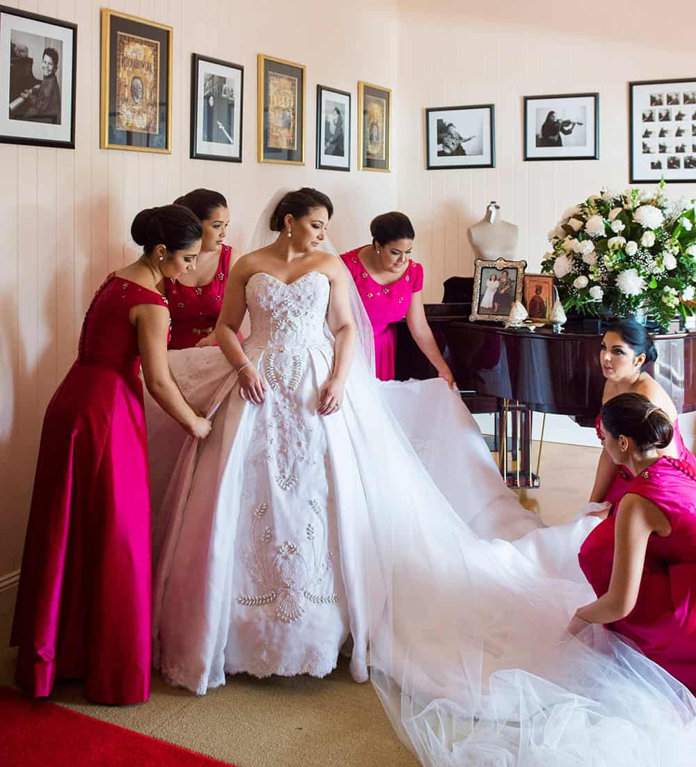 Real bride Catherine Giorgas with her bridal party getting ready for the wedding at the Greek Club.