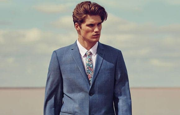 Groom style by Roger David.