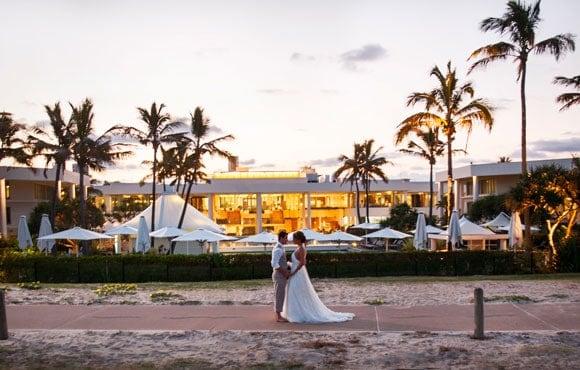 A beachside wedding at golden hour
