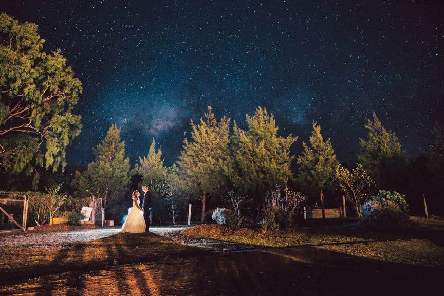 Under the night sky.