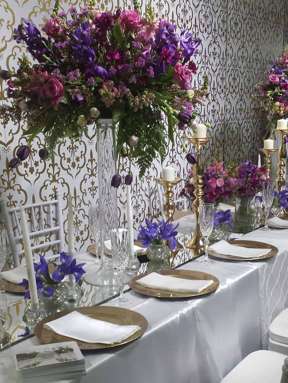 receptions trends: bespoke backdrops with wallpaper and florals.