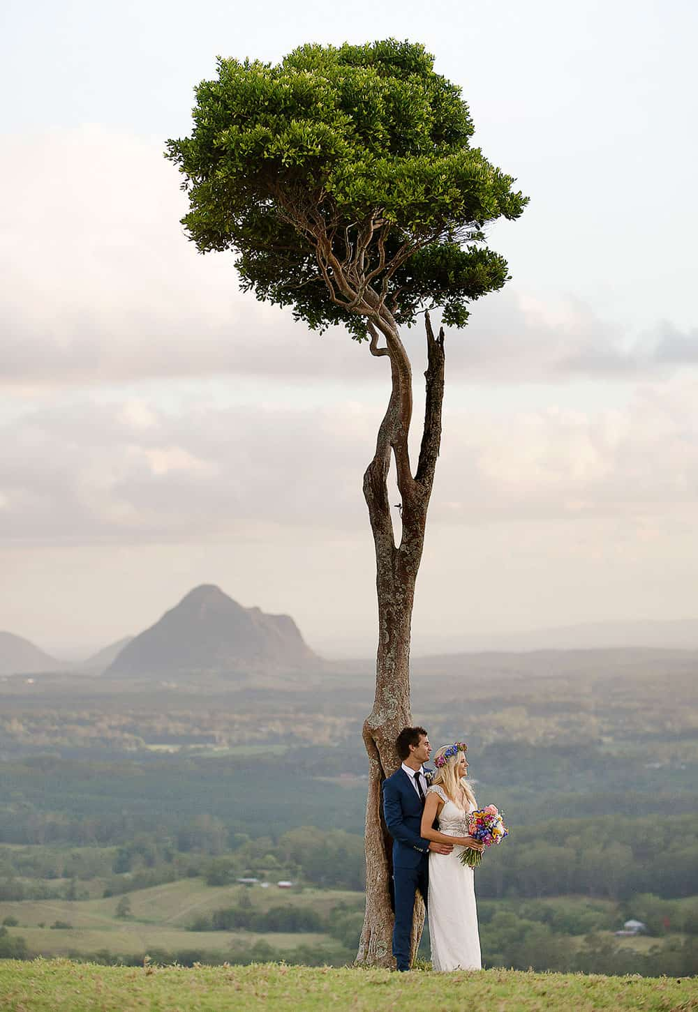 A bride and groom at One Tree Hill on the Sunshine Coast for their hinterland wedding by Christopher Thomas Photography.