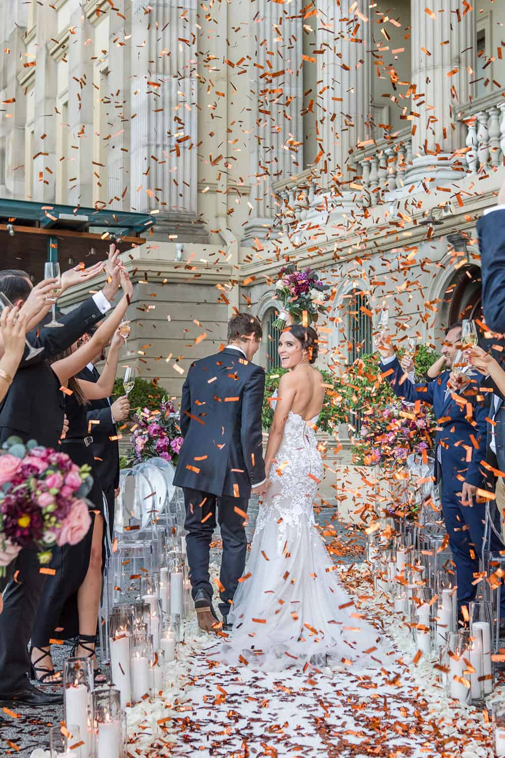Bride and groom with confetti at Customs House.