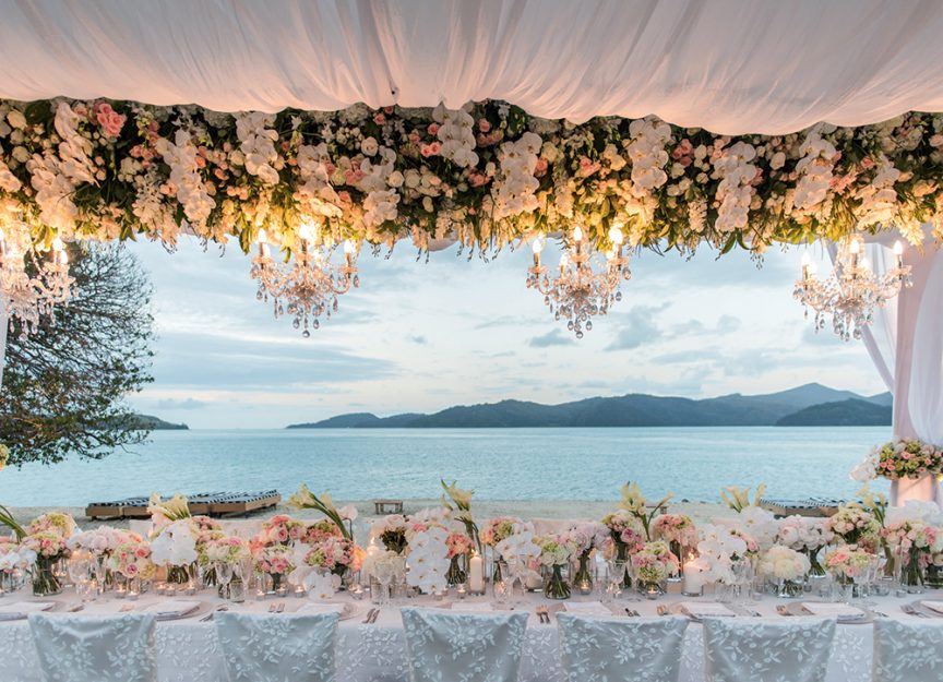Wedding florals at a seaside reception