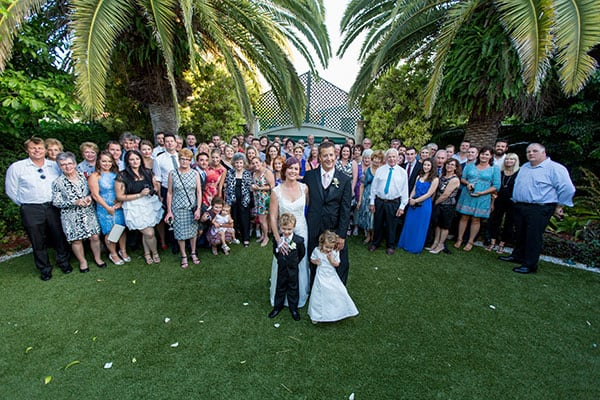 Bride, groom and their wedding guests group shot at The Golden Ox in Redcliffe.