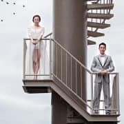 e and groom on a spiral staircase