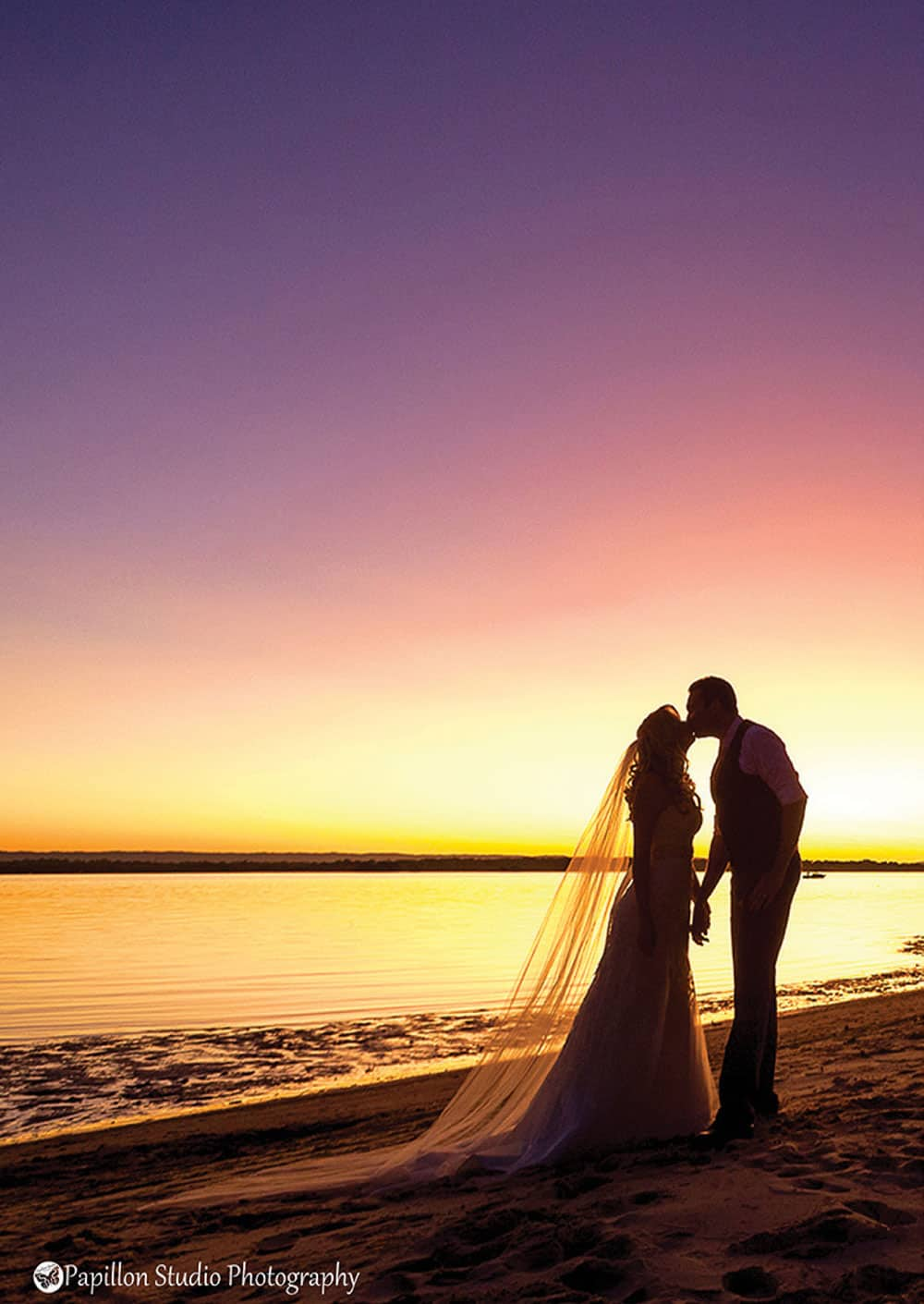 A Brisbane bayside venue. Bride and groom on the beach at sunset