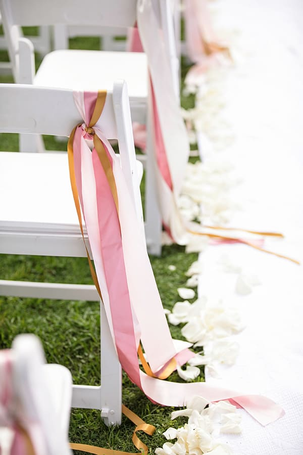 aisle chairs with ribbon