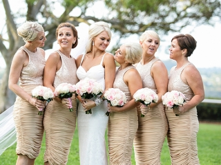bride and bridesmaids wearing champagne colour dresses