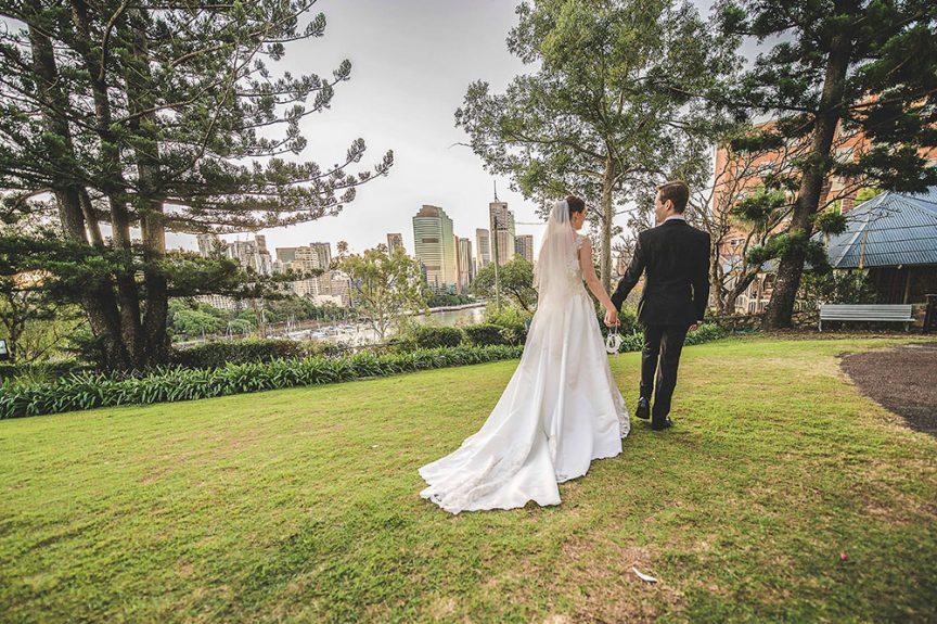 wedding couple walking riverside in Brisbane