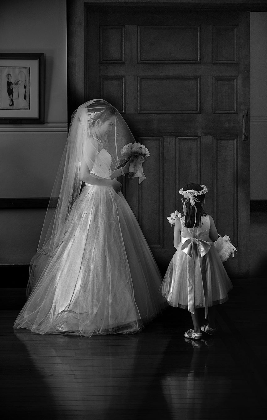 Bride and flower girl image by Christopher Thomas Photography