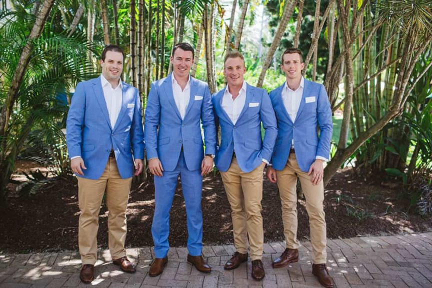 groomsmen in blue and tan suits