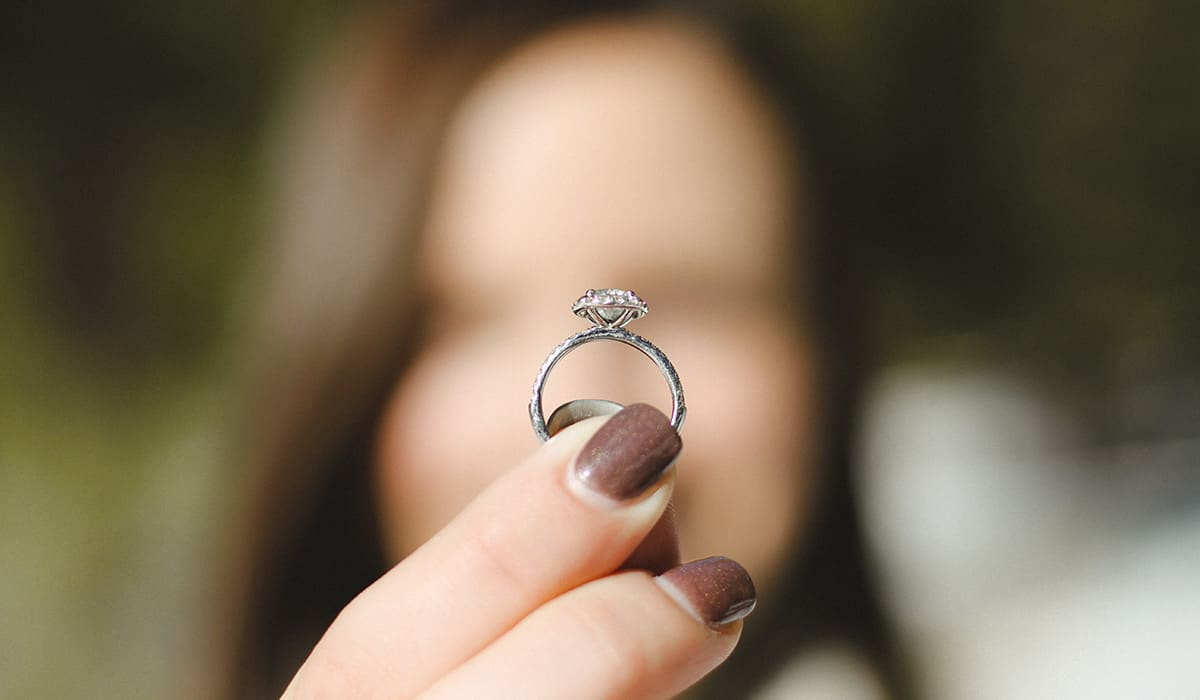 Unsplash-woman-holding-engagement-ring