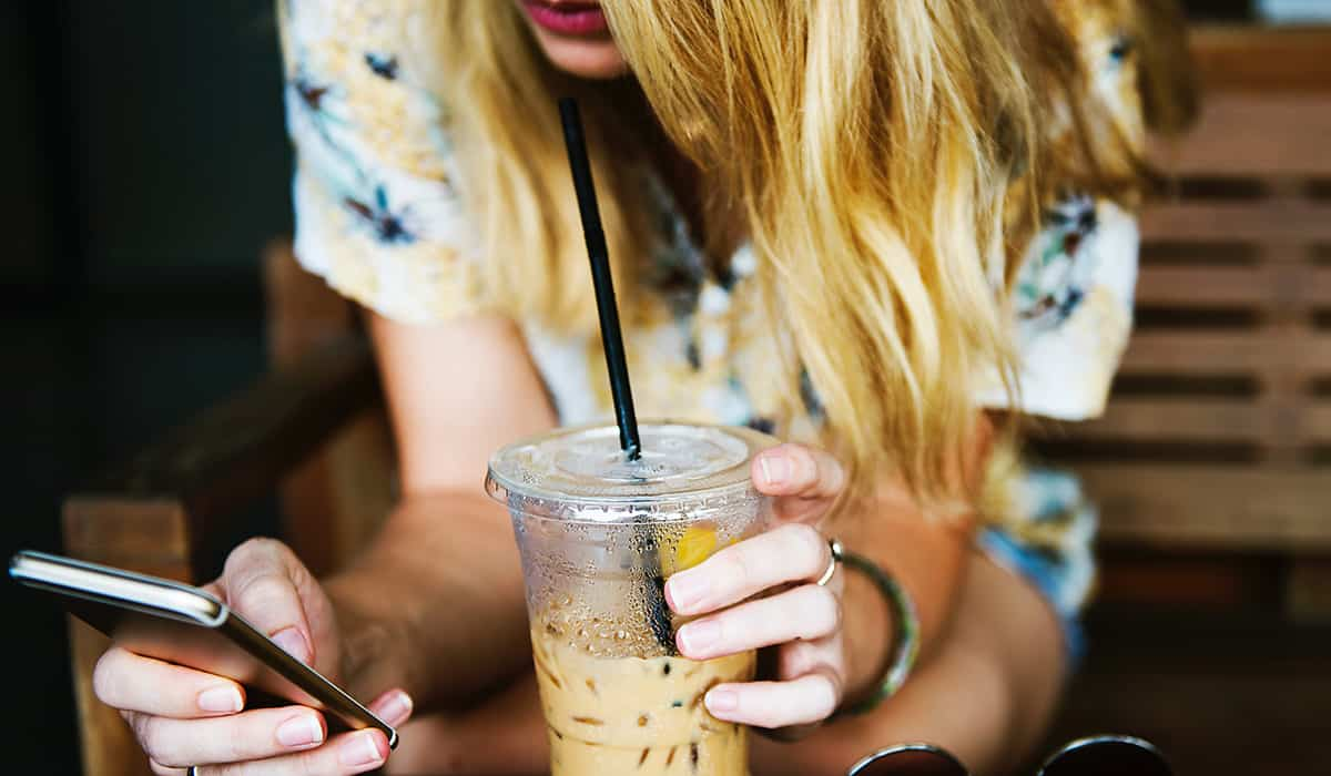 Unsplash-woman-on-phone-with-iced-coffee