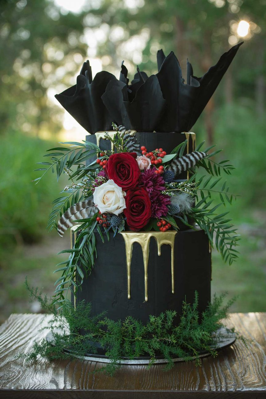 black, gold and red wedding cake