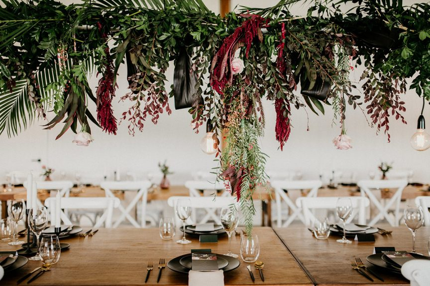 hanging flowers and greenery at wedding reception