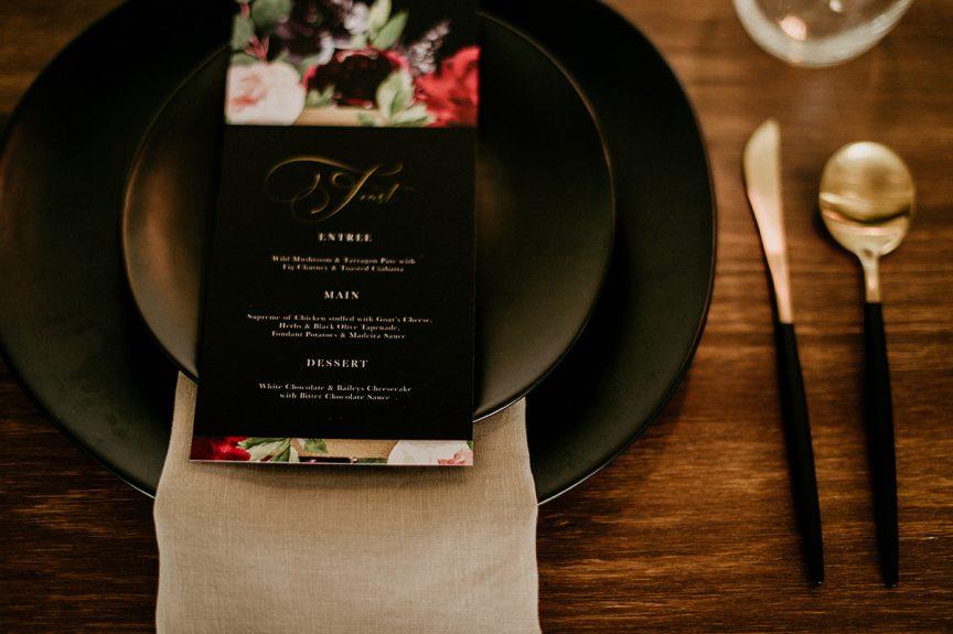 black plate at wedding reception